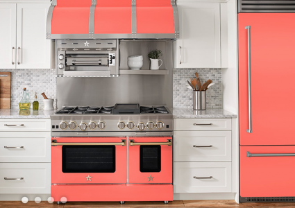 White kitchen with coral appliances, refrigerator, hood and range, by BlueStar Cooking